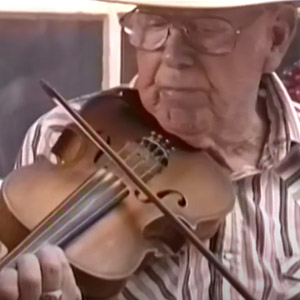 Old time musician Charlie Acuff playing the fiddle
