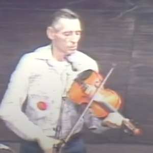 Fiddle player Harvey Sampson playing old time music on stage