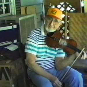 Fiddler Snake Chapman playing old time music sitting on the front porch