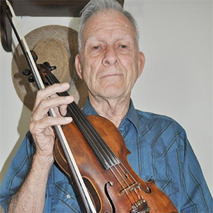Old time fiddler Cecil Goforth posing with is fiddle